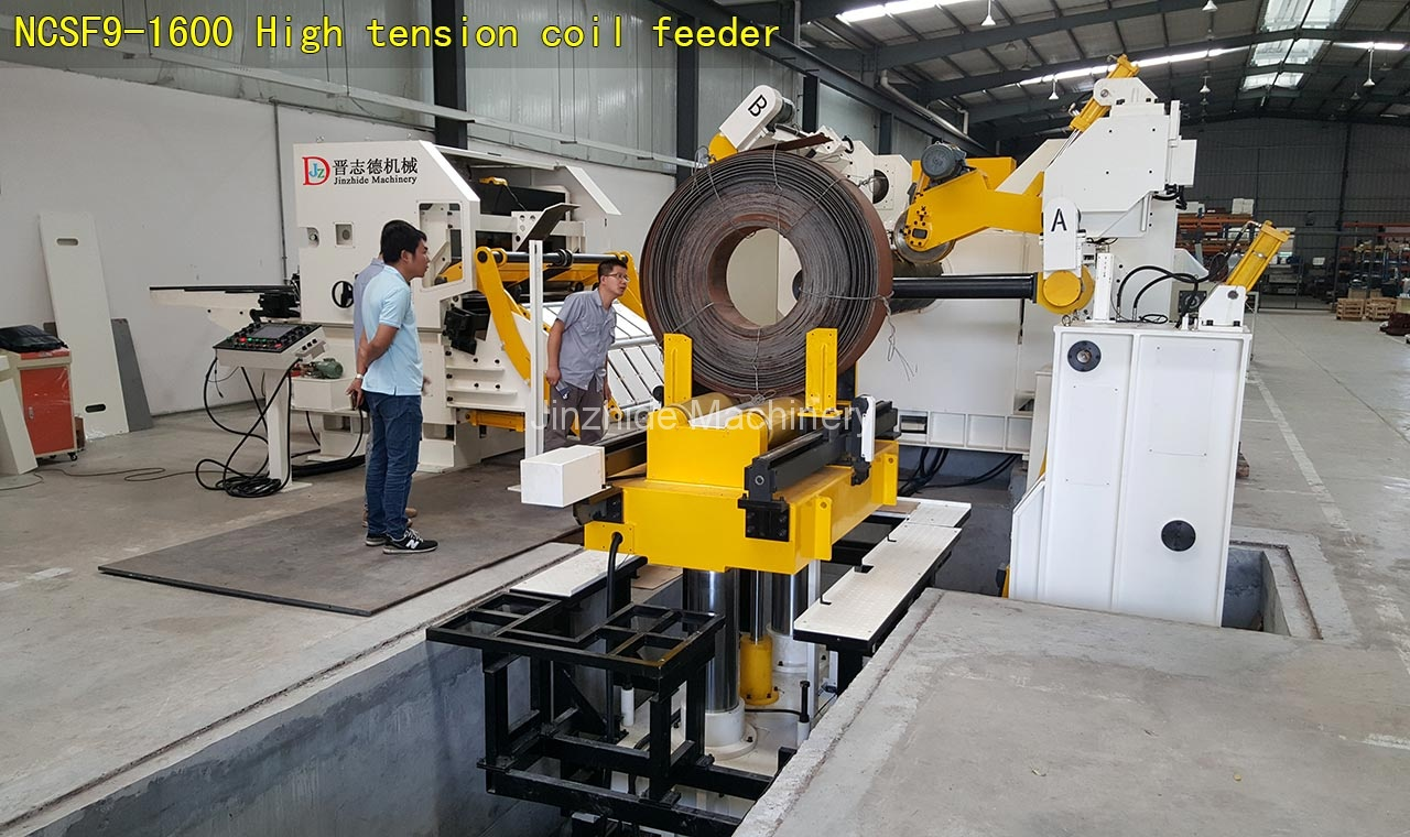 High-tension-coil-feeder-assembly
